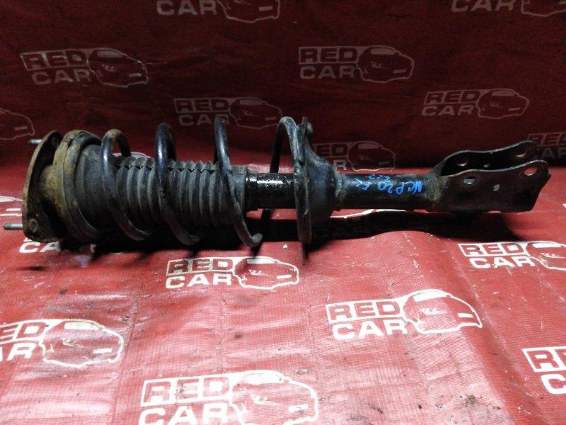 Стойка Toyota Funcargo NCP20-0222182 2NZ-2068157 2001 передняя левая (б/у)