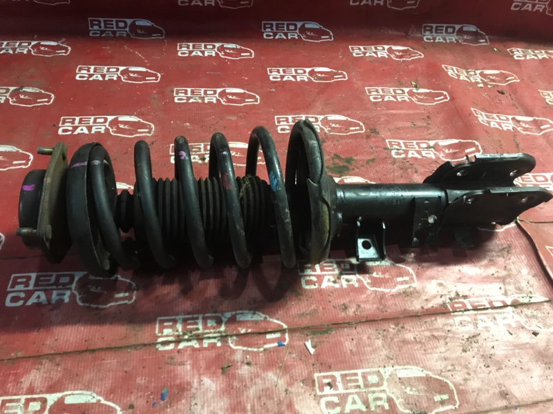 Стойка Nissan Elgrand AVWE50-010398 QD32-035887A 1997 передняя правая (б/у)