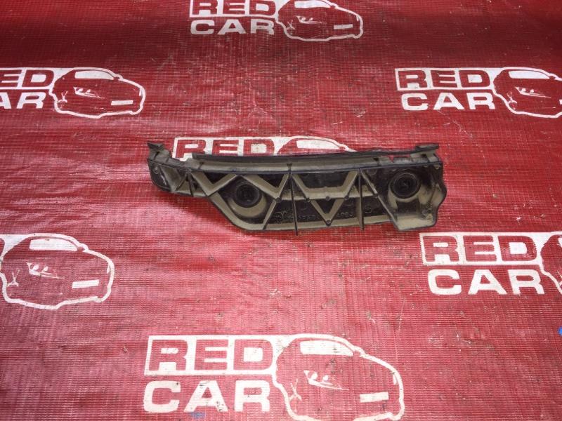 Крепление бампера Toyota Spacio NZE121-3229404 1NZ-A964237 2003 заднее левое (б/у)