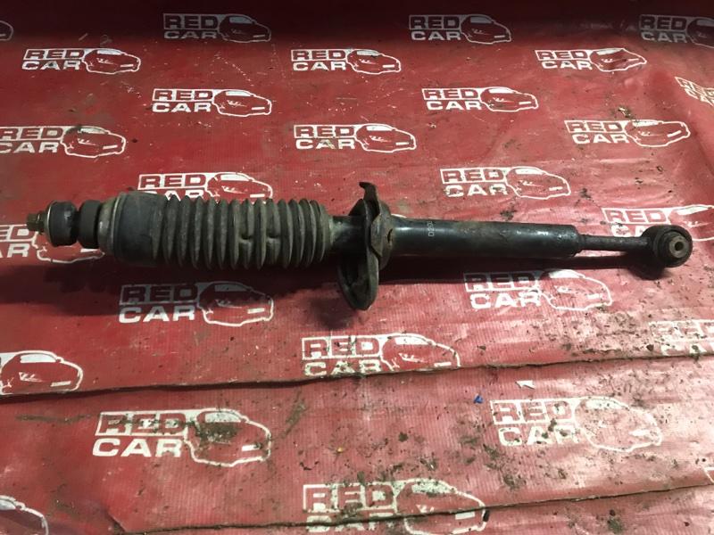 Стойка Mazda Demio DW3W-147186 B3-489336 1997 задняя левая (б/у)