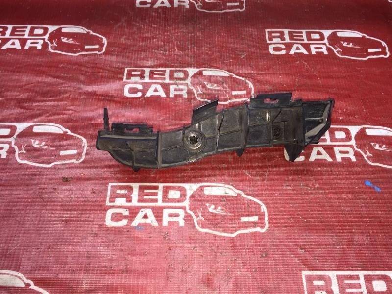Крепление бампера Toyota Corolla Axio NZE144-6010485 1NZ 2008 заднее правое (б/у)