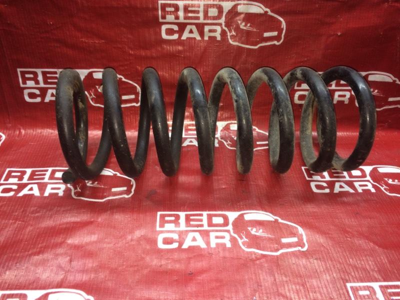 Пружина Nissan Elgrand AVWE50-010398 QD32 1997 задняя (б/у)