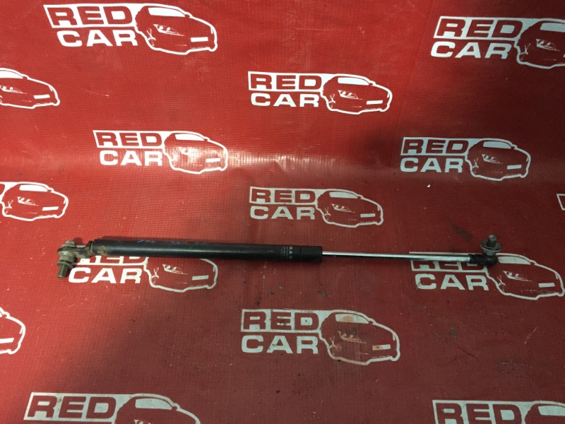 Амортизатор задней двери Suzuki Jimny JB23W-213260 K6A 2000 (б/у)