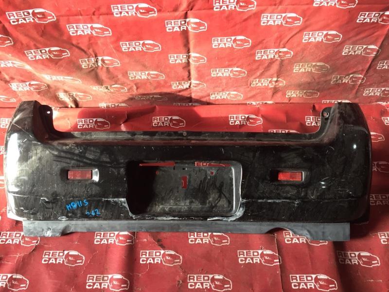 Бампер Mazda Laputa HP11S-601060 F6A-2624121 1999 задний (б/у)
