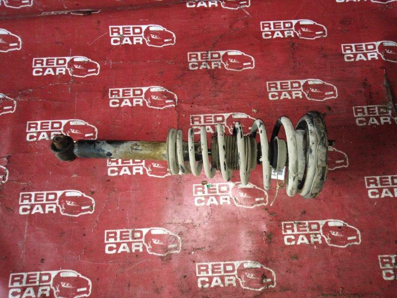 Стойка Nissan Bluebird SU14-105853 CD20-752972X 1999 передняя левая (б/у)