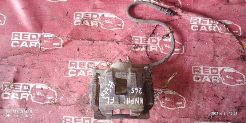 Суппорт Toyota Porte NNP11-5016639 1NZ-C636436 2007 передний левый (б/у)