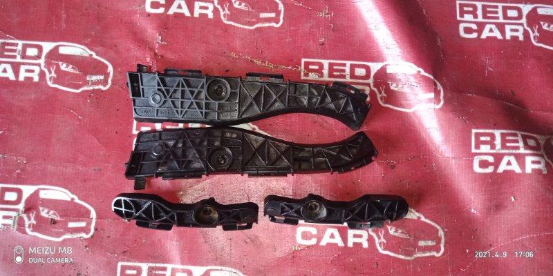 Крепление бампера Toyota Porte NNP11-5016639 1NZ-C636436 2007 заднее (б/у)