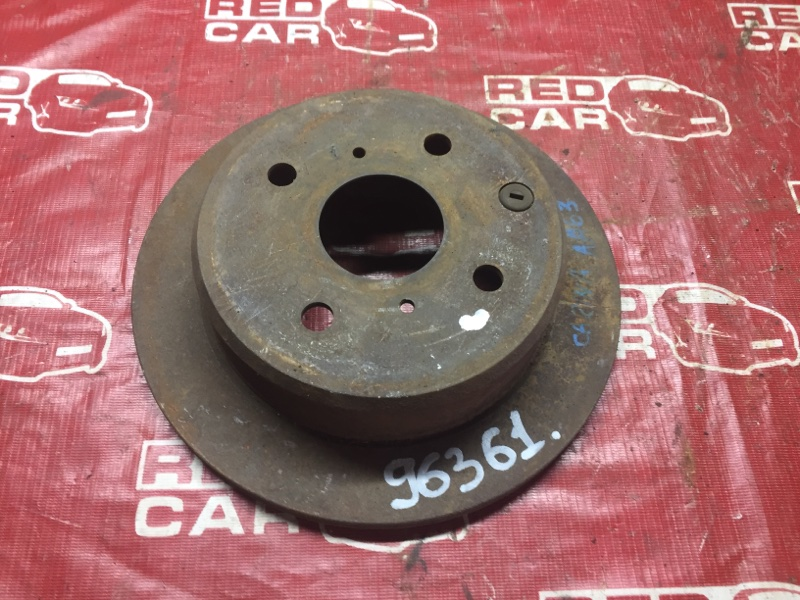 Тормозной диск Toyota Carina AA63 задний (б/у)