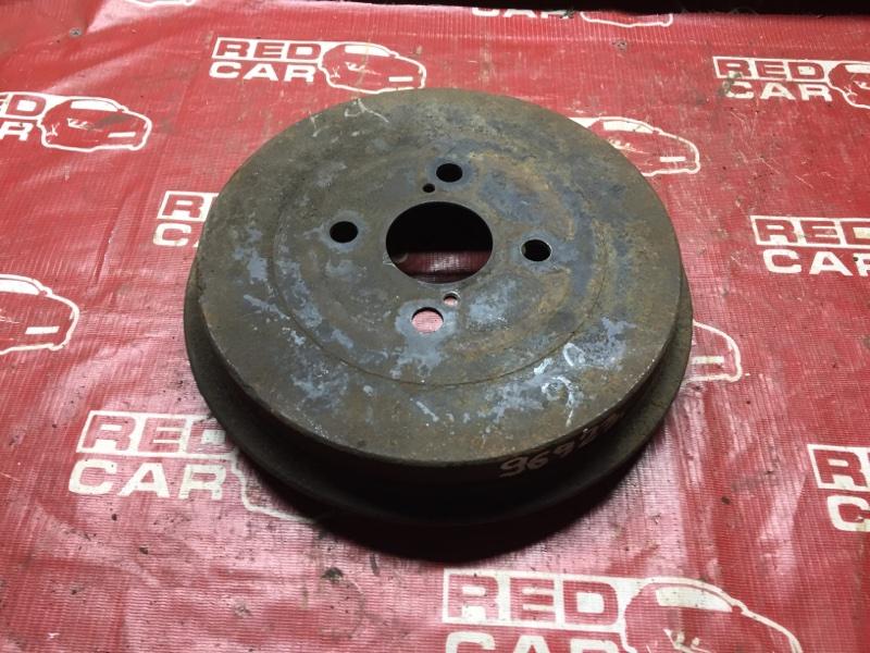 Тормозной барабан Toyota Ractis SCP100 задний (б/у)