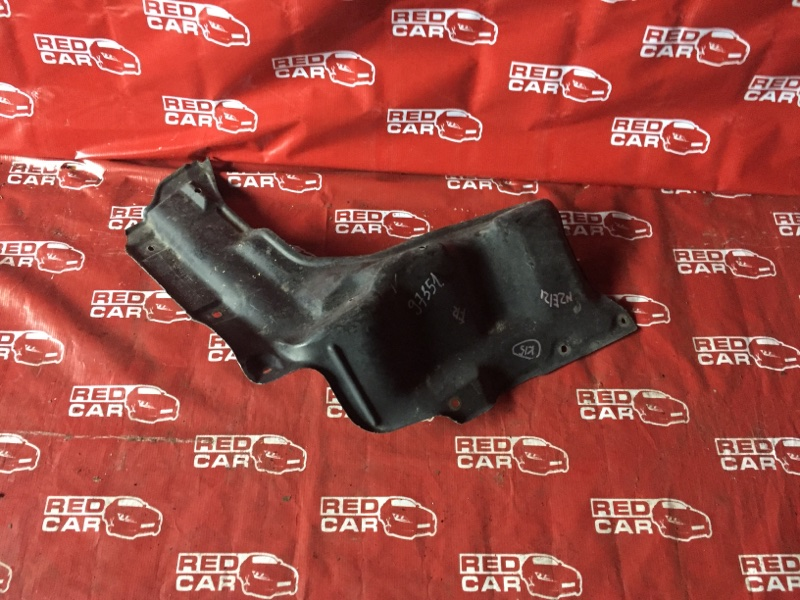 Защита двигателя Toyota Corolla NZE121-0268655 1NZ-B012374 передняя правая (б/у)