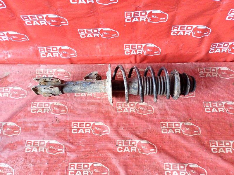 Стойка Toyota Ractis NCP105-0006171 1NZ-C036969 2006 передняя левая (б/у)