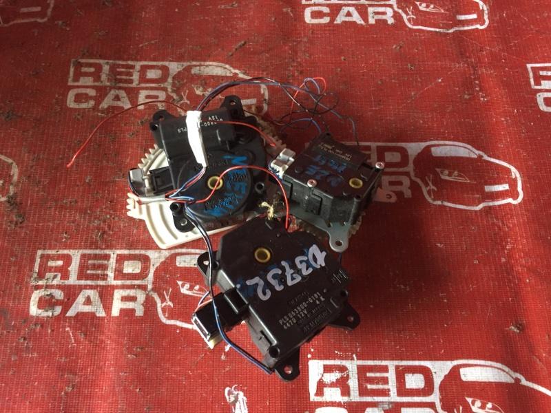 Сервопривод заслонок печки Toyota Corolla Axio NZE141 (б/у)