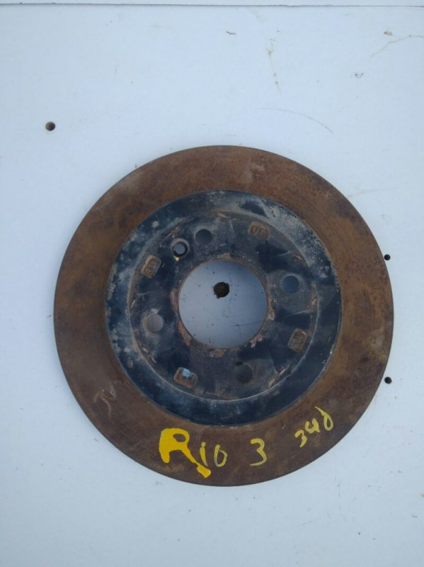 Тормозной диск Kia Rio 3 QB G4FA 2013 задний (б/у)