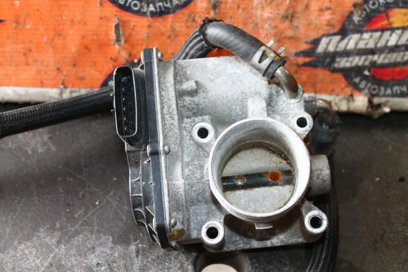 Заслонка дроссельная Toyota Corolla Axio NZE141 1NZ (б/у)