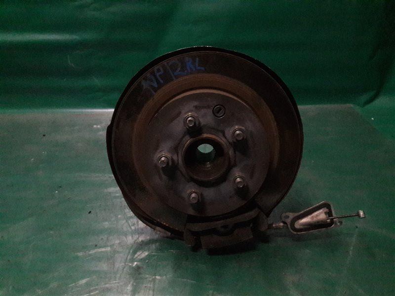 Тормозной диск Nissan Primera TP12 QR20(DE) 2002 задний