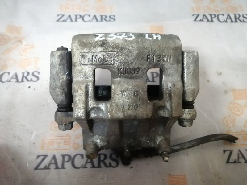 Тормозной суппорт Mazda Cx-7 L3-VDT 2009 передний левый (б/у)