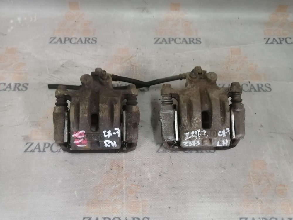Тормозной суппорт Mazda Cx-7 L3-VDT 2008 задний (б/у)