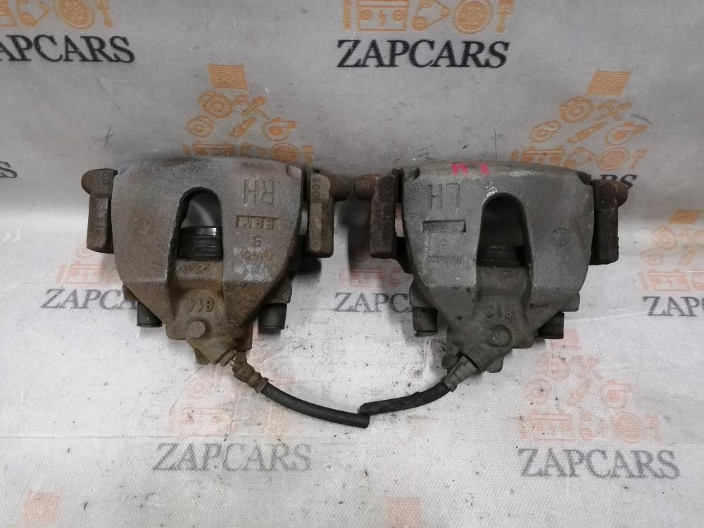 Тормозной суппорт Mazda 3 передний (б/у)