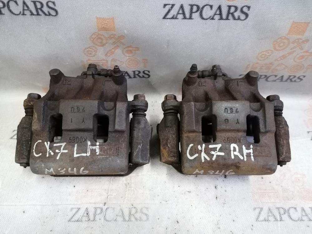 Тормозной суппорт Mazda Cx-7 L3-VDT передний (б/у)