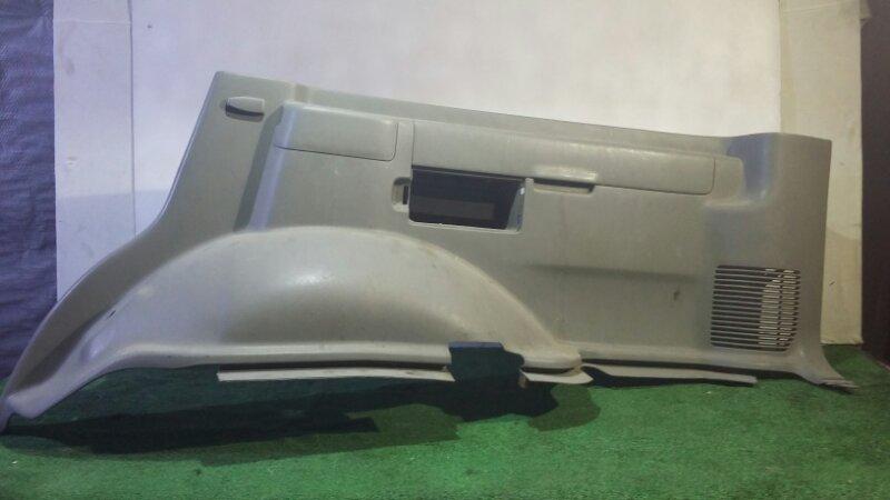 Обшивка багажника Toyota Land Cruiser FZJ100 1HZ 1998 задняя правая нижняя (б/у)