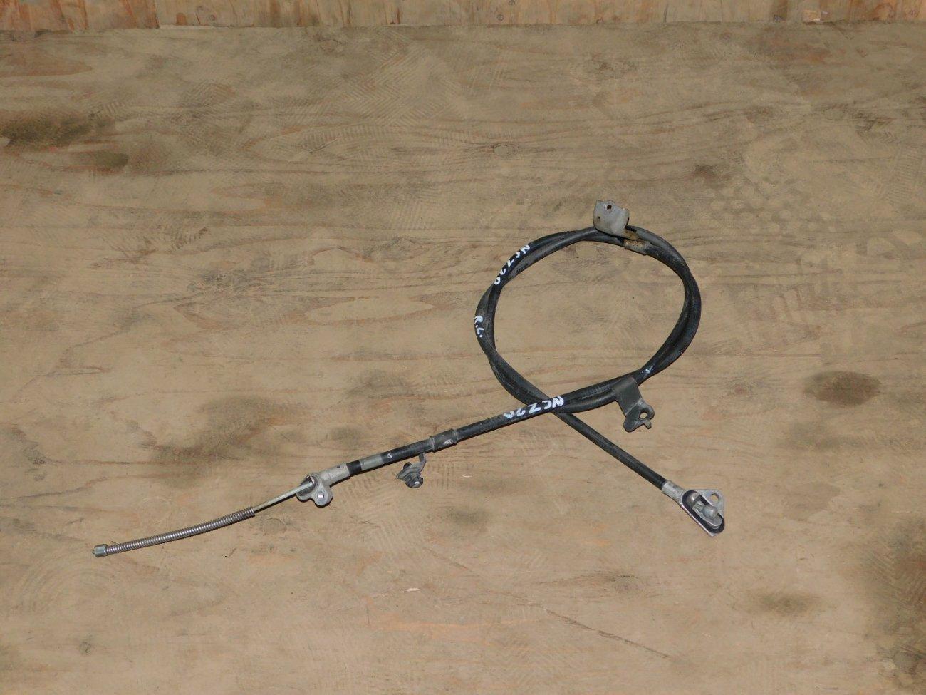 Тросик ручника Toyota Raum NCZ20 1NZFE задний левый (б/у)