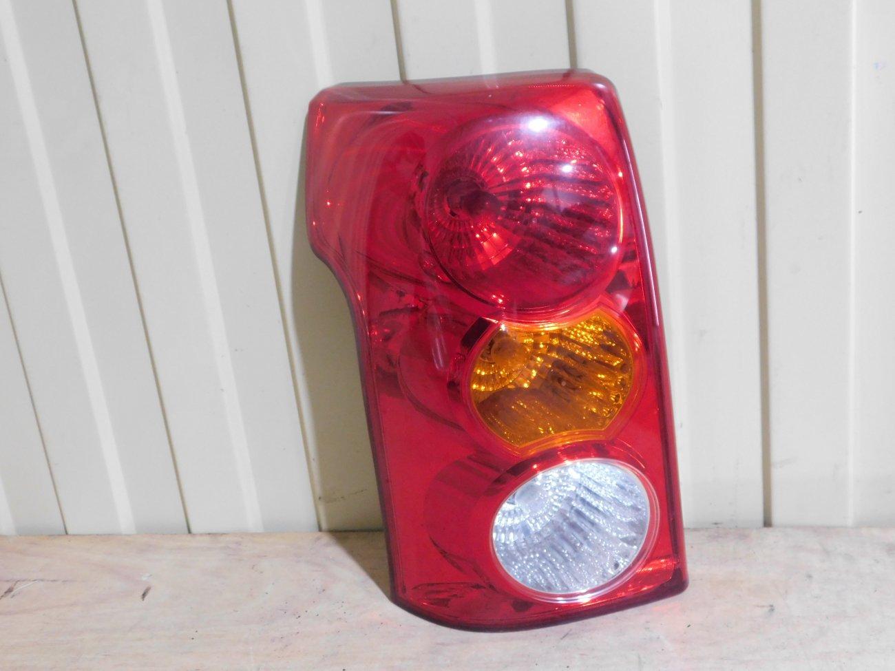 Стоп-сигнал Toyota Raum NCZ20 задний левый (б/у)