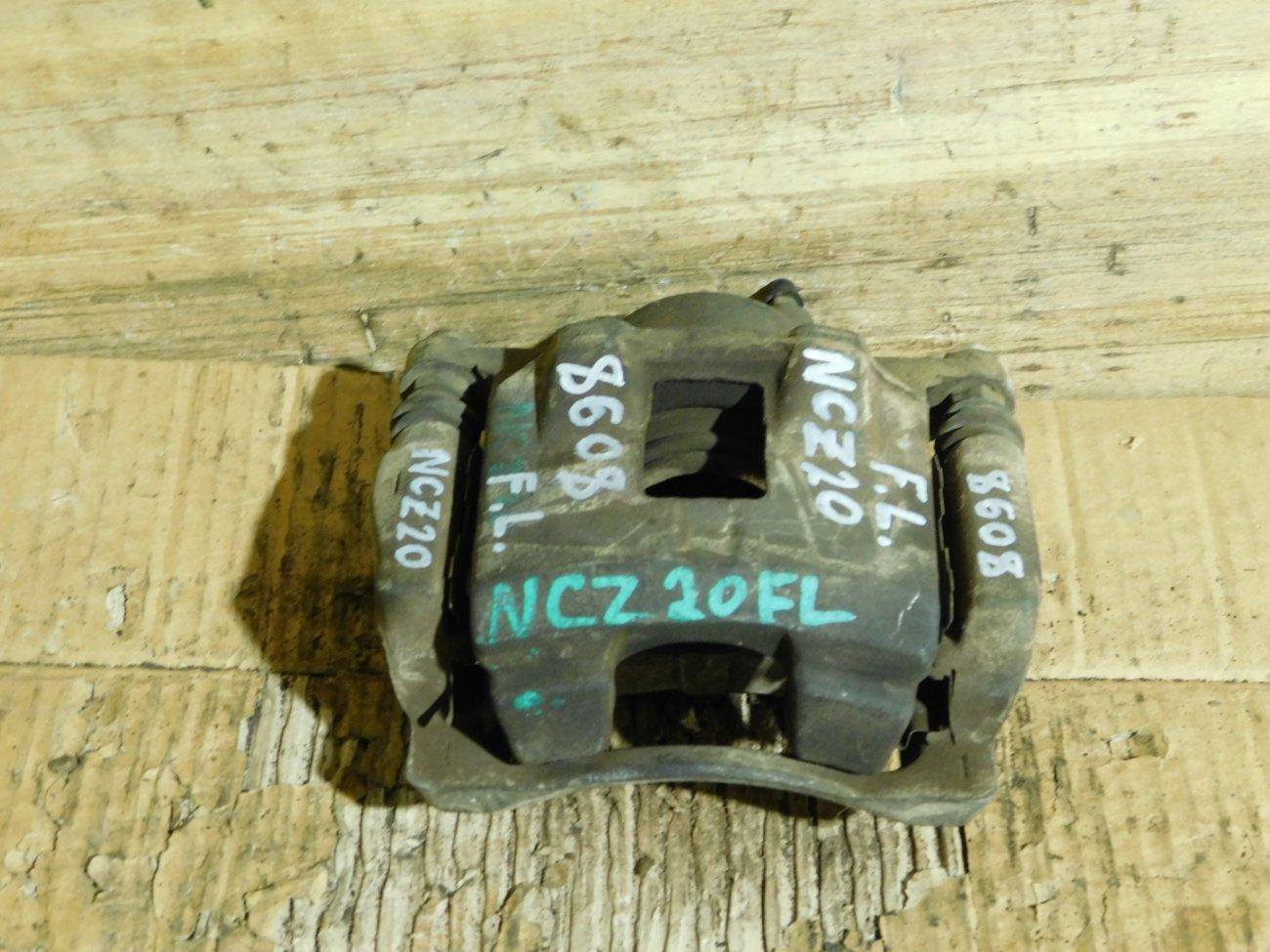 Суппорт Toyota Porte NNP10 1NZ-FE передний левый (б/у)