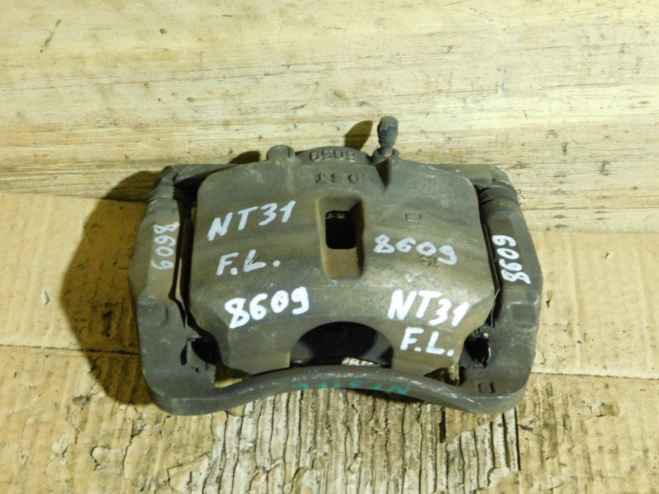 Суппорт Nissan X-Trail NT31 MR20DE передний левый (б/у)
