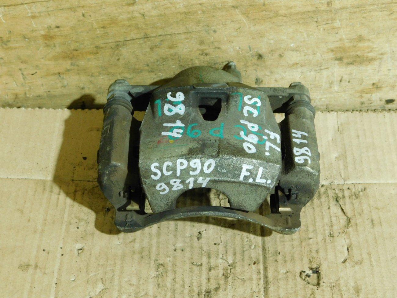 Суппорт Toyota Vitz SCP90 2SZ-FE передний левый (б/у)