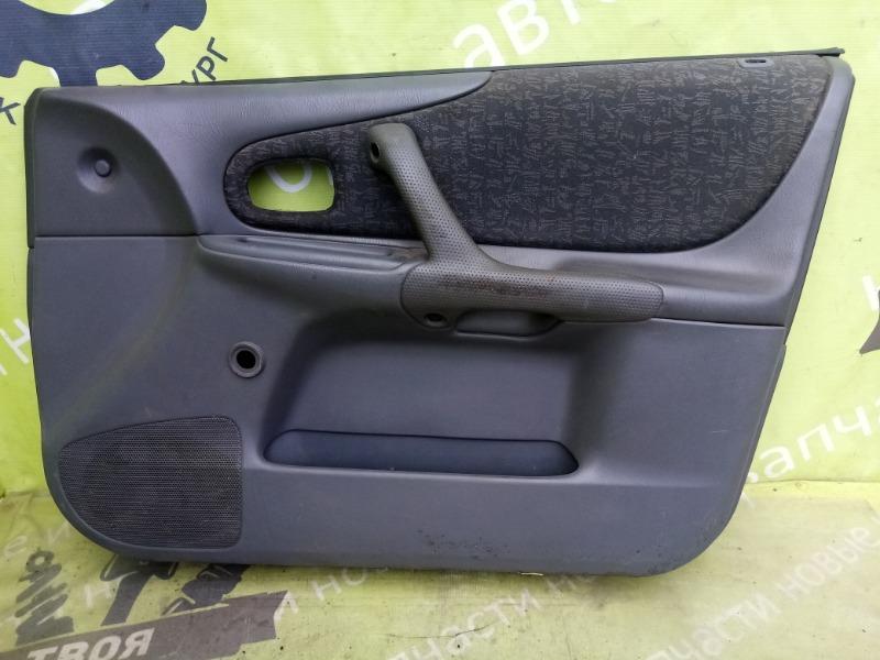 Обшивка двери Mazda 323 Bj передняя правая (б/у)