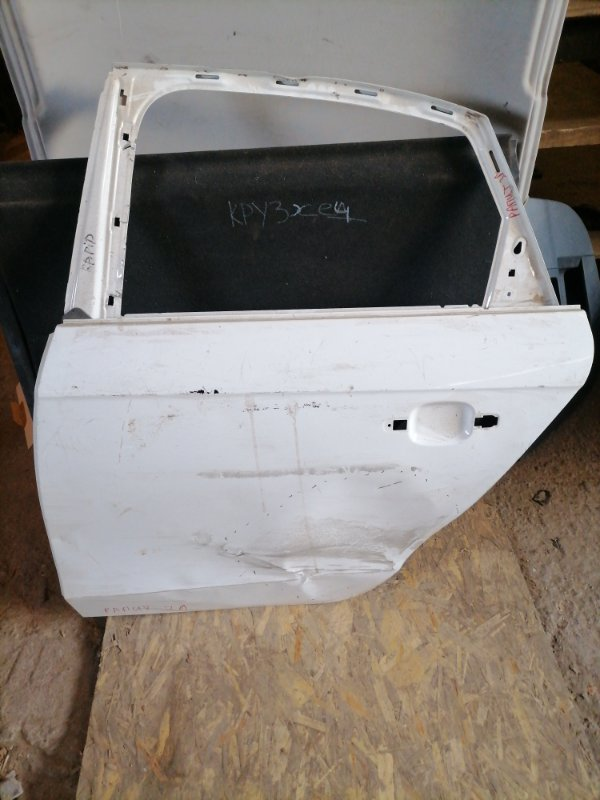 Дверь Skoda Rapid задняя левая (б/у)