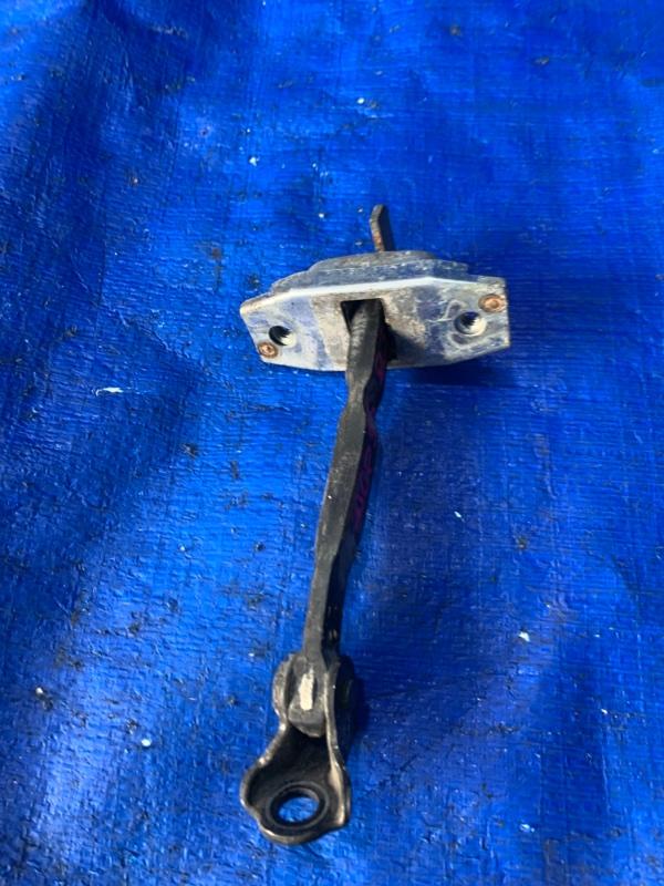 Ограничитель двери Toyota Probox NCP55 1NZFE передний левый (б/у)