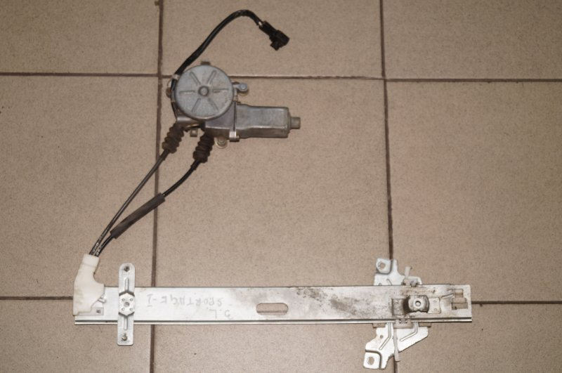 Стеклоподъемник эл. Kia Sportage 1 JA 2.0 FE 2000 задний левый (б/у)