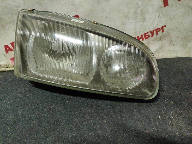 Фара Mitsubishi Delica PE8W правая