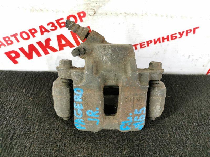 Суппорт тормозной Mitsubishi Pajero Junior передний левый