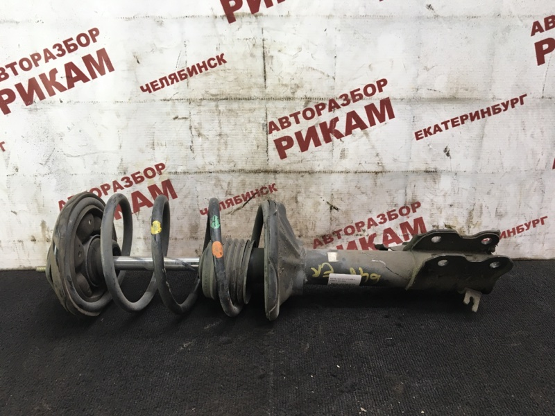 Стойка Nissan Pulsar EN15 GA16DE 1999 передняя правая