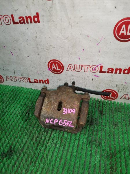 Суппорт тормозной Toyota Ist NCP65 передний левый