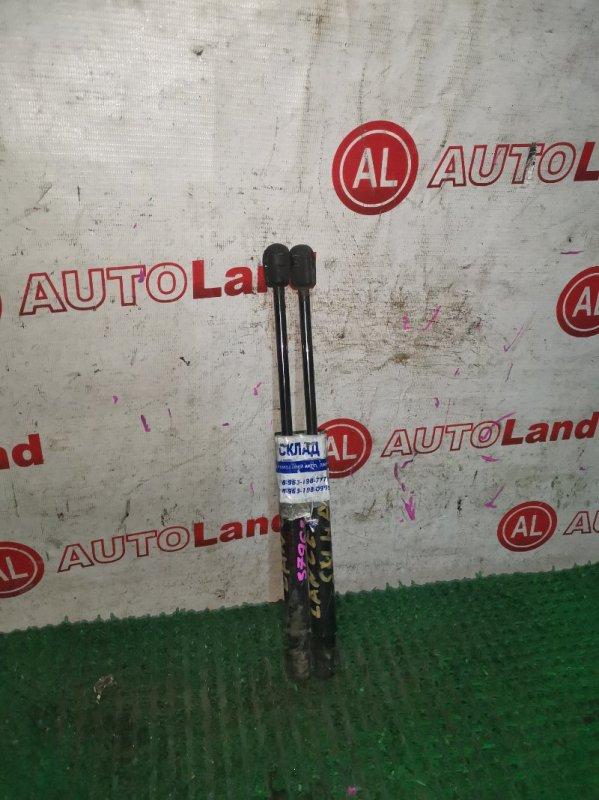 Амортизатор багажника Mitsubishi Lancer CY4A