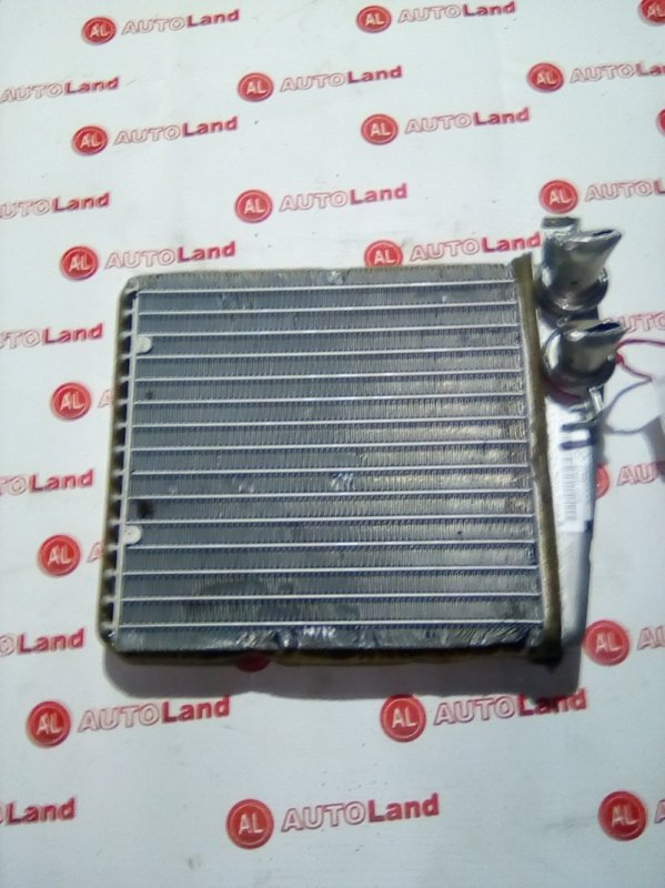 Радиатор печки Nissan March K12