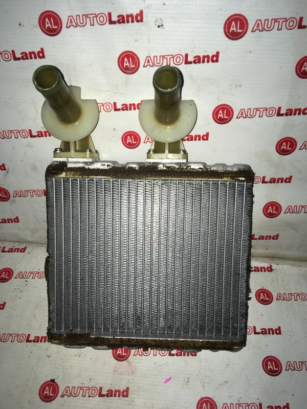 Радиатор печки Nissan March K11