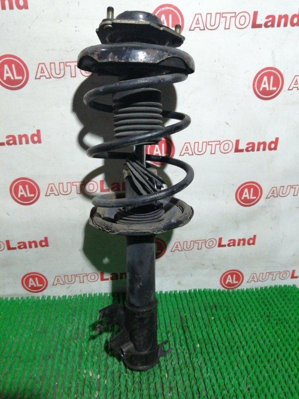 Стойка Nissan Tino V10 передняя правая
