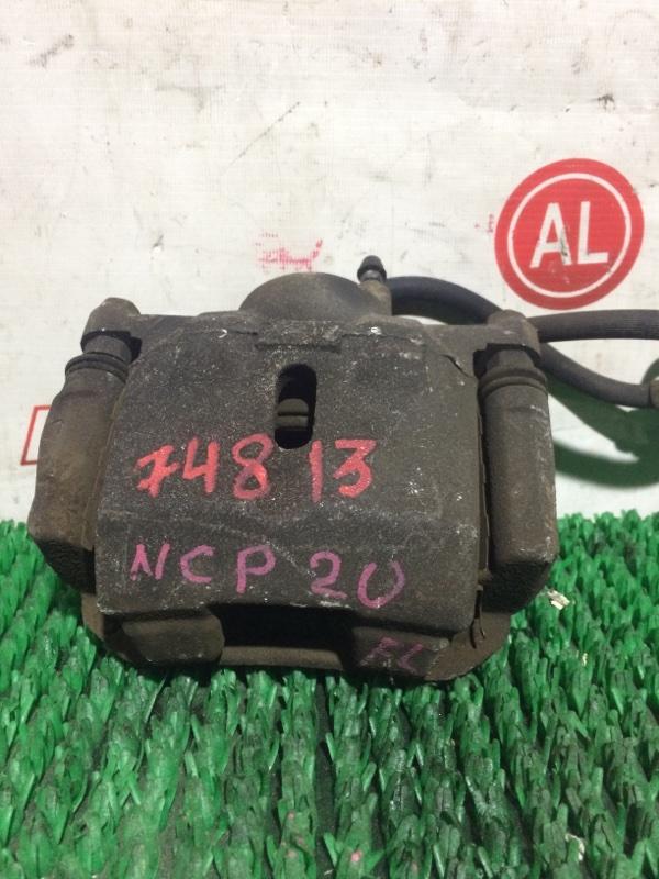 Суппорт тормозной Toyota Funcargo NCP21 передний левый