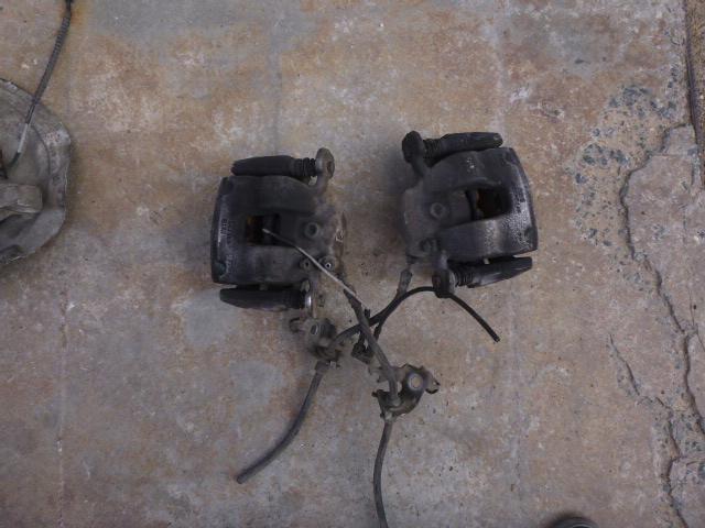 Суппорт тормозной Bmw X1 F48 2015 передний левый (б/у)