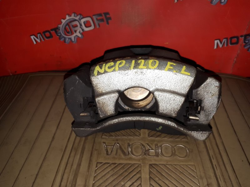 Суппорт Toyota Ractis NCP120 1NZ-FE 2010 передний левый (б/у)