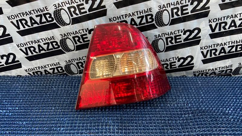 Фонарь Toyota Corolla NZE121-3009477 1NZ-FE 2000 задний правый
