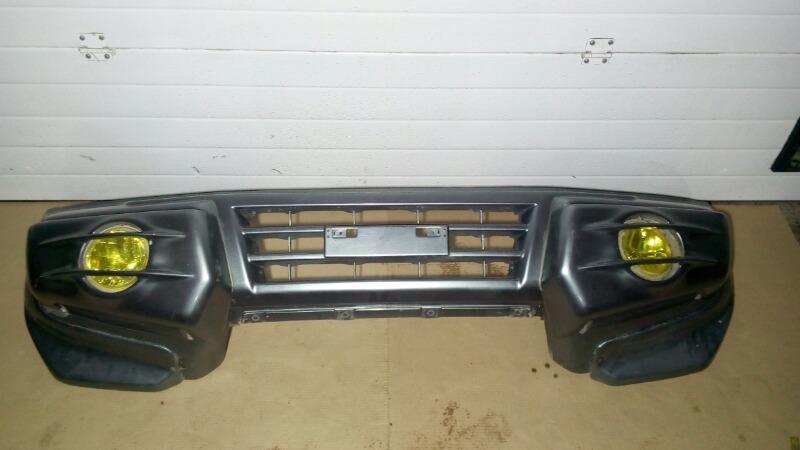 Бампер Mitsubishi Pajero V75W 6G74 2000 передний