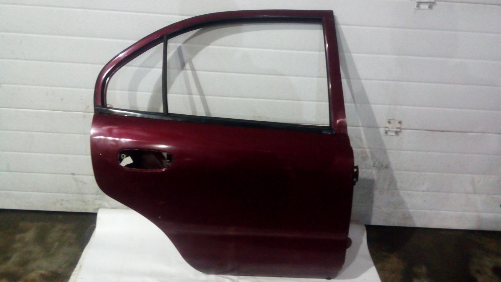 Дверь Mitsubishi Carisma DA1A 4G92 1997 задняя правая