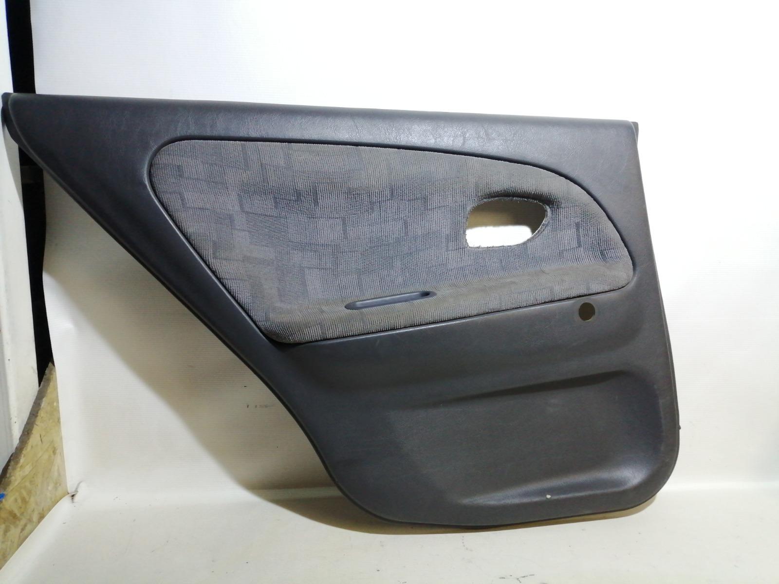 Обшивка двери Mitsubishi Mirage CM2A 4G15 2000 задняя левая