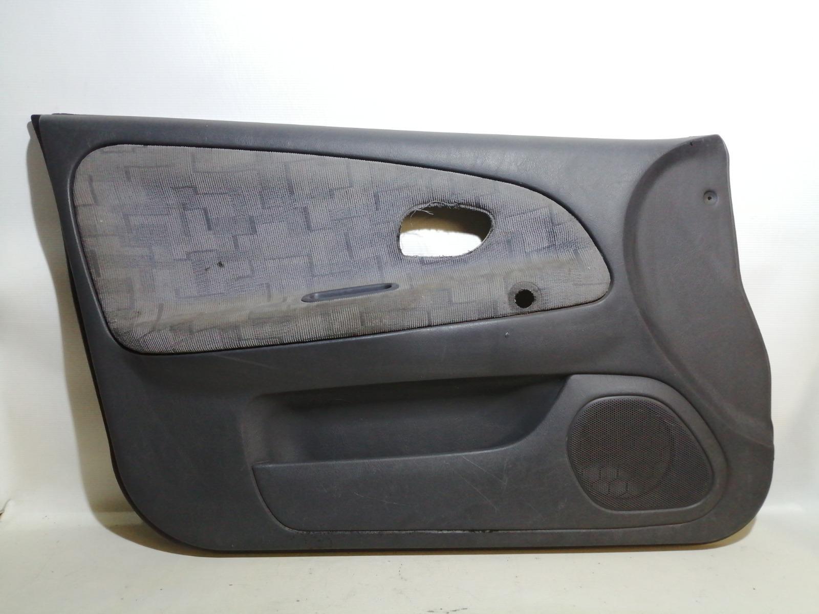 Обшивка двери Mitsubishi Mirage CM2A 4G15 2000 передняя левая
