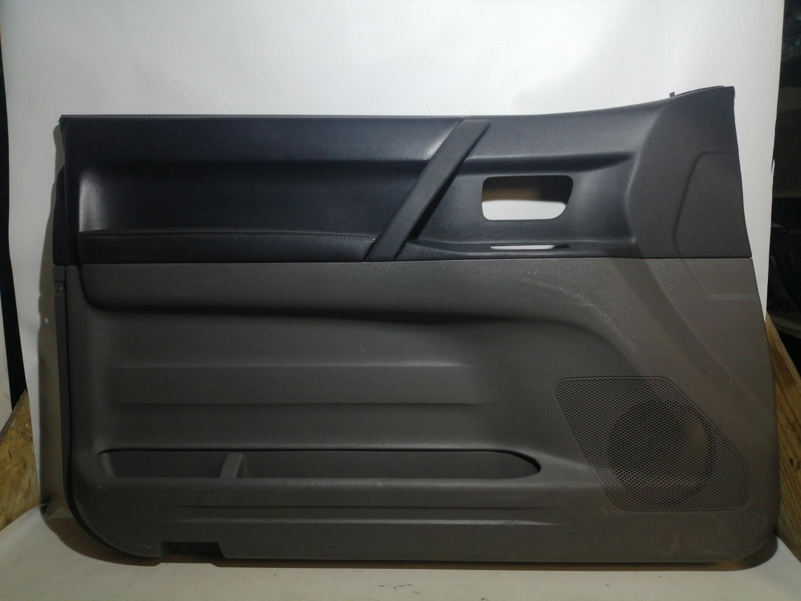 Обшивка двери Mitsubishi Pajero V65W 6G74 2003 передняя левая
